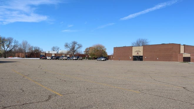 A few cars belonging to teachers are all that were in the Montevideo High School parking lot on Tuesday. The district went to all distance learning on Monday due to an increase in local COVID-19 cases.