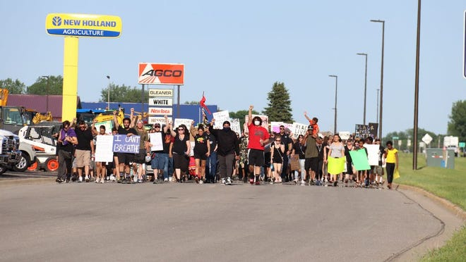 Hundreds of people took part in a march for peace from the municipal airport to Ramsey Park in Redwood Falls June 5.