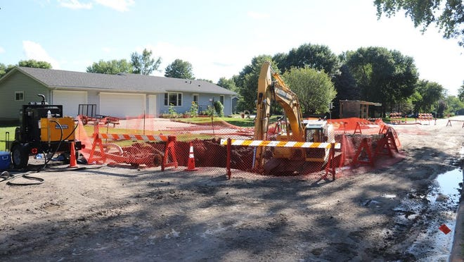 A large sinkhole appeared in Northwood Drive in Redwood Falls this past Friday, and city staff have been working since then to make the necessary repairs.