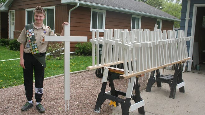 As part of his Eagle Scout award, Cameron Miner painted all of the crosses used during the Belview Memorial Day program.