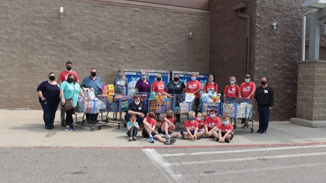 A number of representatives from Gloria Dei Lutheran and First United Methodist churches in Redwood Falls, with assistance from Walmart employees, collected cereal and peanut butter for the school backpack program and the local food shelf.