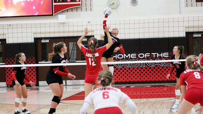 Sydney Sommers led the way for the Cardinals with 13 kills as Redwood Valley held off rival Jackson County Central 3-2.