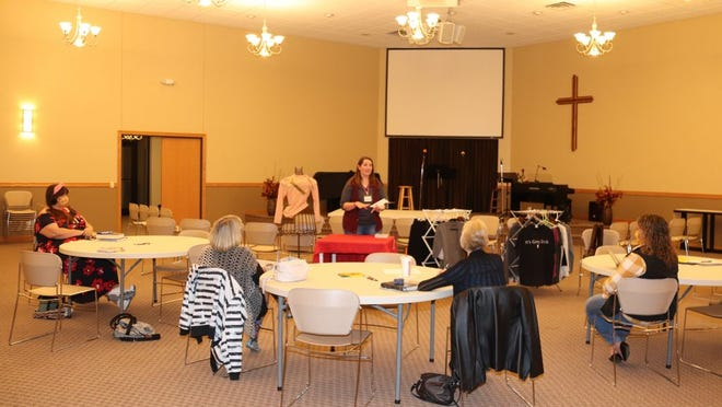 """Sarah Behrendt (above center) presented a program entitled """"Clothes in Closests"""" in October. All moms are welcome to attend the Nov. 5 meeting."""