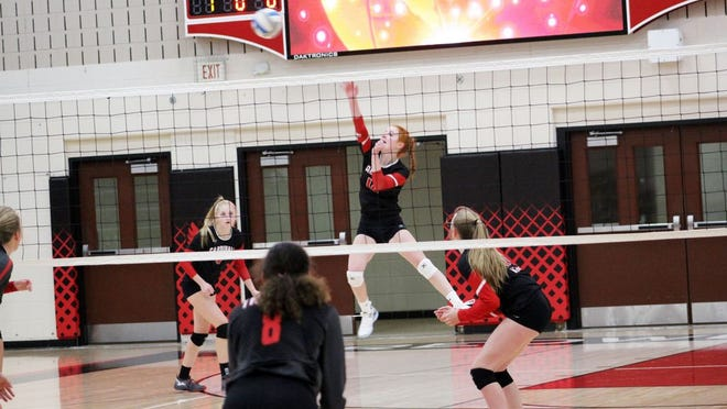 Kate Ahrens (middle) led the way for the Cardinals with 16 kills in the narrow 3-2 loss to Jackson County Central. Redwood Valley will host Marshall this Tuesday night.