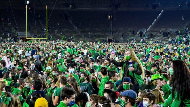 Fans storm the field after Notre Dame defeated the Clemson 47-40 in two overtimes in an NCAA college football game Saturday, Nov. 7, 2020, in South Bend, Ind. (Matt Cashore/Pool Photo via AP