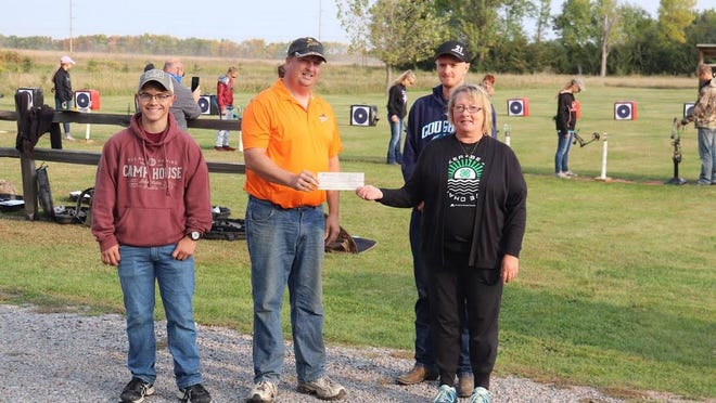 Redwood County Pheasants Forever Chapter President Ray Sweetman (middle left) presents a $500 check to Stacy Johnson, County 4-H educator (right), and 4-H ambassadors Kody Robinson (left) and Tanner Mathiowetz (back) for sponsorship of the Regional 4-H Shooting Sports competition. Other sponsors included The Redwood County VFW Post 2553, Sunriser's Chapter of the MN Deer Hunters Association and Redwood Falls American Legion Post #38.