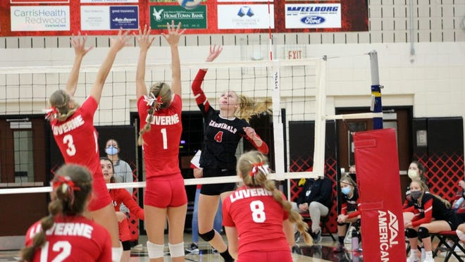 Hannah Schjenken battles at the net with the Luverne front line.