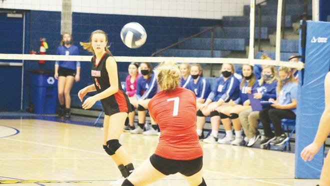 Senior Hallie Bigley, No. 7, gets the hit for Ravenswood during the battle for the Net at Ripley's Health Center.