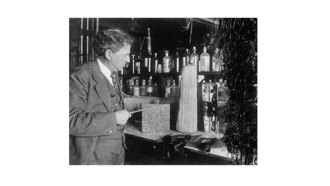 In 1930, U.S. Department of Agriculture, corn cobs were made into many valuable by-products. Dr. W.W. Skinner is shown next to samples of by-products, including furfural, lignin, ethyl alcohol, etc.