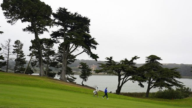 Davis Love III, right, walks on the 15th fairway during practice for the PGA Championship golf tournament at TPC Harding Park in San Francisco, Tuesday, Aug. 4, 2020.
