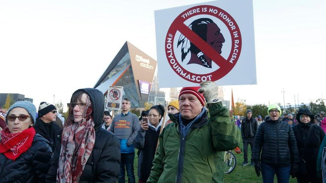 In this Oct. 24, 2019, file photo, Native American leaders protest against the Redskins team name outside U.S. Bank Stadium before an NFL football game between the Minnesota Vikings and the Washington Redskins in Minneapolis. A new name must still be selected for the Washington Redskins football team, one of the oldest and most storied teams in the National Football League, and it was unclear how soon that will happen. But for now, arguably the most polarizing name in North American professional sports is gone at a time of reckoning over racial injustice, iconography and racism in the U.S.
