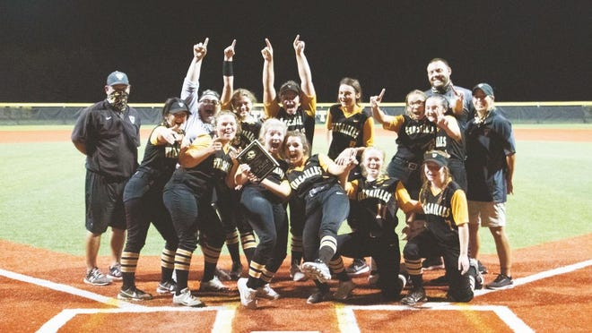 The Versailles softball team celebrates the championship of its own tournament on Saturday, September 26, in Versailles.
