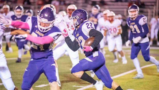 Senior Jadin Faulconer rushes through a hole in the Glendale defense for a first down.