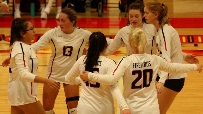 Devils Lake volleyball players celebrate after scoring a point in a game against Wahpeton on Sept. 12 at Devils Lake High School. The Firebirds won 3-2