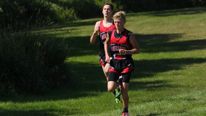 Devils Lake varsity runners Tyler Goss and Gabe Houle lead the pack at the Grahams Island Invitational on Sept. 12.