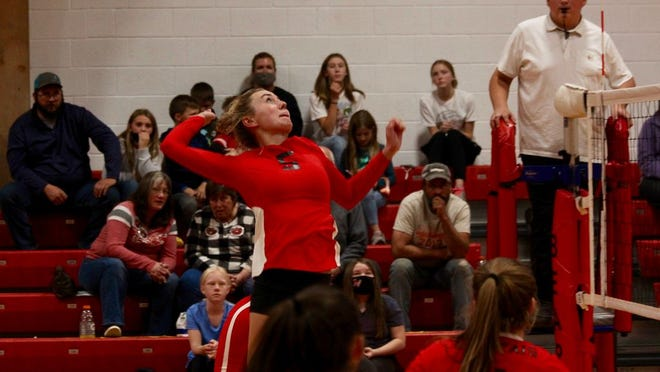 junior middle hitter Danielle Hagler goes up for a kill in a game against Grafton on Oct. 1 at North Star High School. The Bearcats lost 3-2.