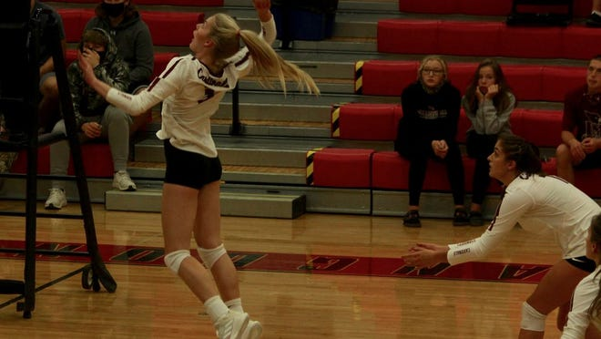 Senior Lexis Olson winds up for a kill in a game against Thompson on Oct. 10 at Langdon Area High School. The Cardinals won 3-1.
