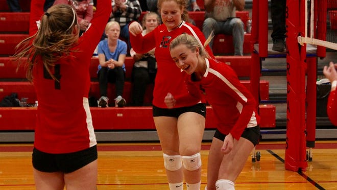 Junior middle blocker Danielle Hagler celebrates with her teammates after scoring a point in a game against Grafton on Oct. 1 at North Star High School. The Bearcats lost 3-2.