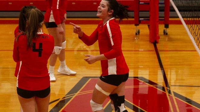 senior middle blocker Mackenzie Gleason point to a teammate in a game against Dunseith on Oct. 27 at North Star High School. The Bearcats won 3-0.