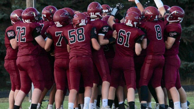 L/E/M players huddle up before a game against Westhope/Newburg/Glenburn on Sept. 25 at Langdon Area High School. The Cardinals won 47-12