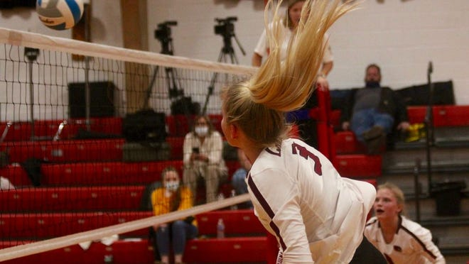 Senior Lexis Olson spikes the ball over then net in a game against North Star on Nov. 2 at North Star High School. The Cardinals won 3-0.