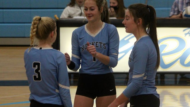Senior middle hitter Kayahna Hopfauf celebrates with her teammates after a successful play during a game against Harvey/Wells on Nov. 10 at New Rockford-Sheyenne School. The Rockets won 3-0.