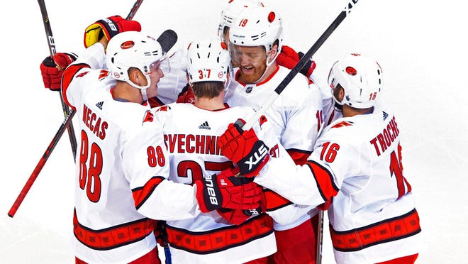 Carolina Hurricanes' Dougie Hamilton (19) celebrates his goal against the Boston Bruins with teammates Martin Necas (88), Andrei Svechnikov (37) and Vincent Trocheck (16) during the third period of an NHL Eastern Conference Stanley Cup hockey playoff game in Toronto, Thursday, Aug. 13, 2020.