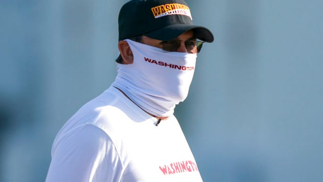 Washington head coach Ron Rivera arrives for practice wearing a face mask, at the team's NFL football training facility, Thursday, Aug. 20, 2020, in Ashburn, Va.