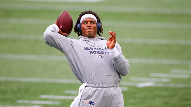 New England Patriots quarterback Cam Newton (1) warms up prior to an NFL football game against the Las Vegas Raiders, Sunday, Sept. 27, 2020, in Foxborough, Mass.