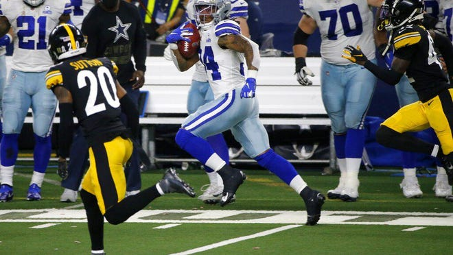 Pittsburgh Steelers' Cameron Sutton (20) and James Pierre (42) give chase as Dallas Cowboys running back Rico Dowdle, a former A.C. Reynolds High standout, returns a kickoff for a long gain in the second half of Sunday's game in Arlington, Texas.