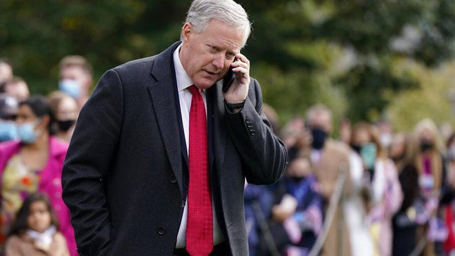 White House chief of staff Mark Meadows speaks on a phone on the South Lawn of the White House in Washington, Friday, Oct. 30, 2020, before President Donald Trump's departure on Marine One. Trump is traveling to campaign events in Michigan, Wisconsin and Minnesota.