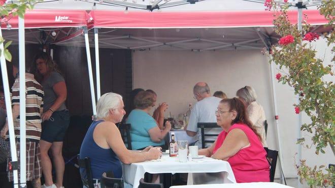 Outdoor diners enjoy Ale's cuisine in October.