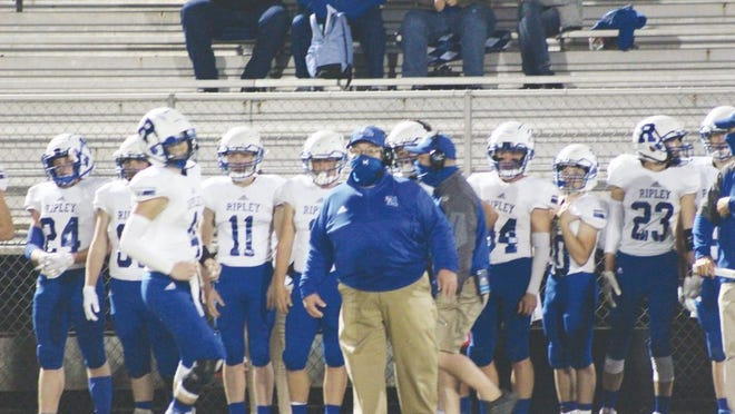 Viking's head coach Steve Sayre (blue jacket) looks on as his team takes the field against the Ravenswood Red Devils in the team's last regular-season game of 2020.