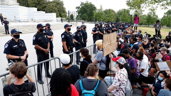 Demonstrators protest the death of George Floyd, Wednesday, June 3, 2020, at the U.S. Capitol in Washington. Floyd died after being restrained by Minneapolis police officers.