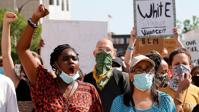 Protesters chant as they march in the street way from the City Justice Center Monday, June 1, 2020, in St. Louis. Protesters gathered to speak out against the death of George Floyd who died after being restrained by Minneapolis police officers on May 25.