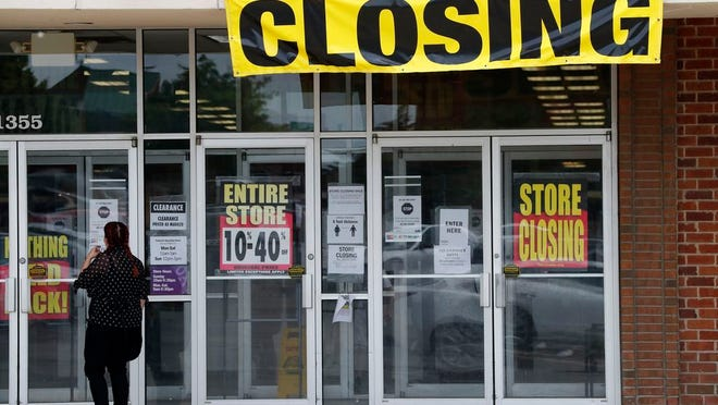 A woman walks into a closing Gordmans store, Thursday, May 28, 2020, in St. Charles, Mo. Stage Stores, which owns Gordmans, is closing all its stores and has filed for Chapter 11 bankruptcy.