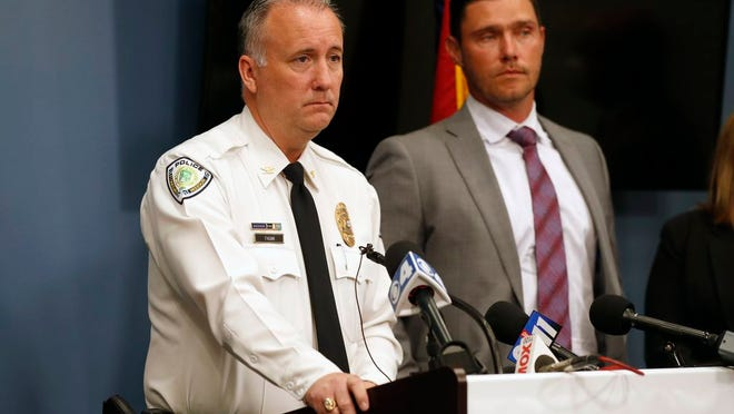 Florissant Police Chief Timothy Fagan, left, speaks alongside St. Charles County Prosecuting Attorney Tim Lohmar, right, during a news conference Wednesday, June 17, 2020, in O'Fallon, Mo. Lohmar, who is acting as special prosecutor in the case against former Florissant Detective Joshua Smith, announced Smith has been charged with two counts of assault and armed criminal action after the now fired detective was apparently captured on video hitting a suspect with a police SUV then kicking and punching the man.