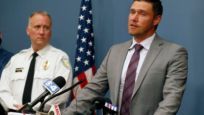 St. Charles County Prosecuting Attorney Tim Lohmar, right, speaks alongside Florissant Police Chief Timothy Fagan during a news conference Wednesday, June 17, 2020, in O'Fallon, Mo. Lohmar, who is acting as special prosecutor in the case against former Florissant Detective Joshua Smith, announced Smith has been charged with two counts of assault and armed criminal action after the now fired detective was apparently captured on video hitting a suspect with a police SUV then kicking and punching the man.