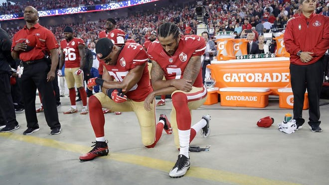 In this Sept. 12, 2016, file photo, San Francisco 49ers safety Eric Reid (35) and quarterback Colin Kaepernick (7) kneel during the national anthem before an NFL football game against the Los Angeles Rams in Santa Clara, Calif.