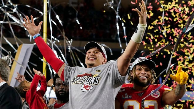 In this Feb. 2, 2020, file photo, Kansas City Chiefs' Patrick Mahomes, left, and Tyrann Mathieu celebrate after defeating the San Francisco 49ers in the NFL Super Bowl 54 football game in Miami Gardens, Fla.