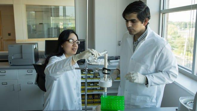 Dr. Sutapa Barua, left, and doctoral student Sidharth Razdan demonstrating the endotoxin removal process.