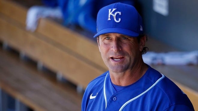 In this March 9, 2020, file photo, Kansas City Royals manager Mike Matheny pauses in the dugout prior to a spring training baseball game against the Arizona Diamondbacks in Scottsdale, Ariz.