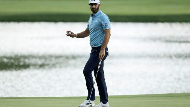 Dustin Johnson reacts after sinking his putt on the 15th green during the final round of the Travelers Championship golf tournament at TPC River Highlands, Sunday, June 28, 2020, in Cromwell, Conn.