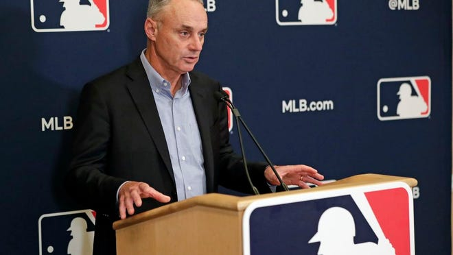 In this Feb. 6, 2020, file photo, Baseball Commissioner Rob Manfred answers questions at a press conference during baseball owners meetings in Orlando, Fla.