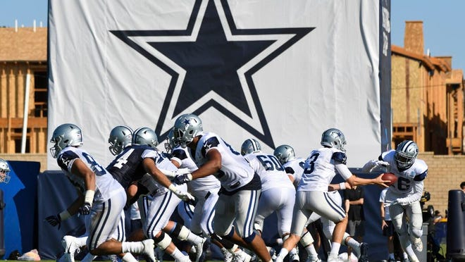In this Monday, July 29, 2019, file photo, Dallas Cowboys practice at the NFL football team's training camp in Oxnard, Calif.