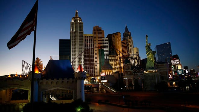 FILE - In this April 28, 2020, file photo, the sun sets behind casinos and hotels along the Las Vegas Strip in Las Vegas.