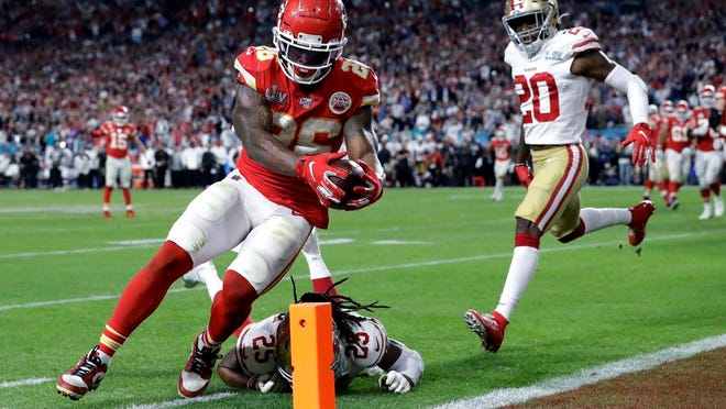 In this Feb. 2, 2020, file photo, Kansas City Chiefs' Damien Williams (26) scores a touchdown against the San Francisco 49ers during the second half of the NFL Super Bowl 54 football game in Miami Gardens, Fla.