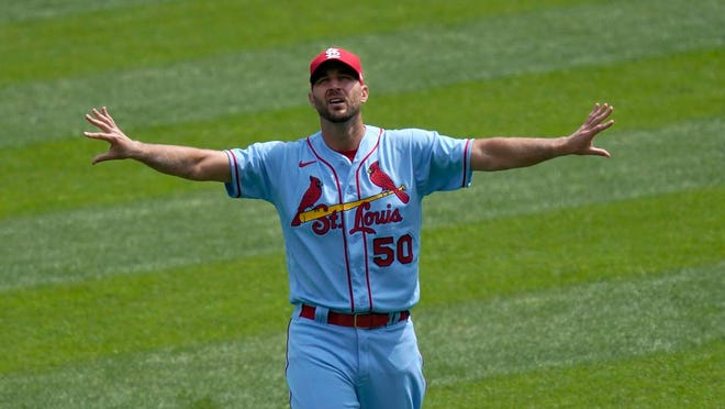 St. Louis Cardinals starting pitcher Adam Wainwright stretches in right field before a baseball game against the Chicago White Sox Saturday, Aug. 15, 2020, in Chicago.