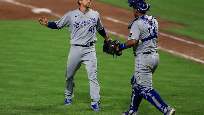 Kansas City Royals' Trevor Rosenthal (40) reacts with catcher Salvador Perez (13) after a baseball game against the Cincinnati Reds in Cincinnati, Wednesday, Aug. 12, 2020. The Royals won 5-4.