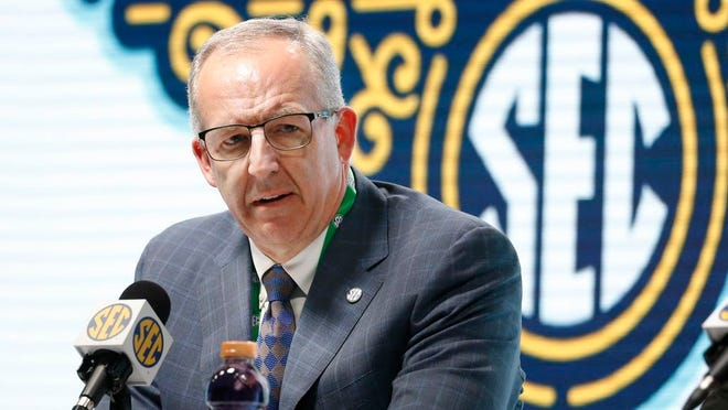 In this March 11, 2020, file photo, Southeastern Conference Commissioner Greg Sankey announces that fans will not be allowed in the arena to watch NCAA college basketball games in the SEC tournament in Nashville, Tenn. After the Power Five conference commissioners met Sunday, Aug. 9, 2020, to discuss mounting concern about whether a college football season can be played in a pandemic, players took to social media to urge leaders to let them play.
